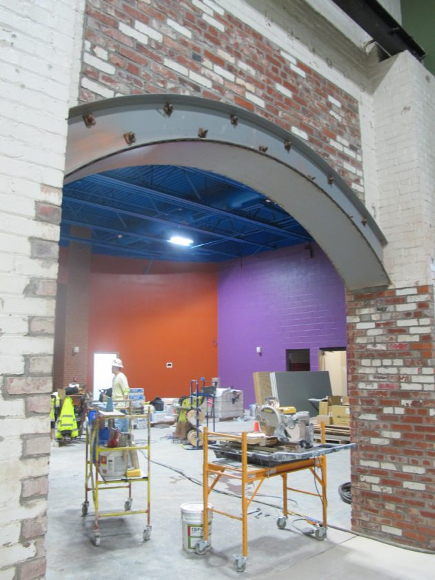 The mixture of old-world brick and new vibrant colors inside the National Comedy Center.