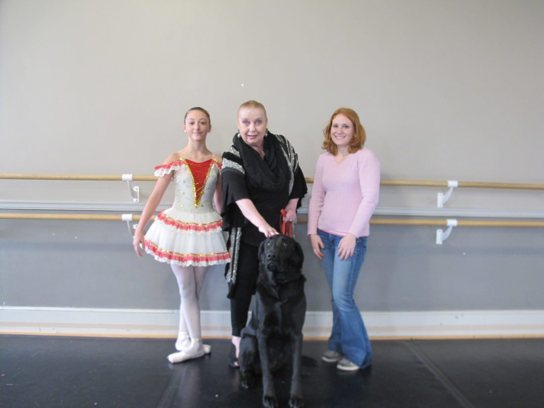 "The Chautauqua Regional Youth Ballet and the Chautauqua County Humane Society have partnered to include an adopted Humane Society dog, Chloe, in the ballet company's annual production of ""The Nutcracker."" Pictured with Chloe, from left, are: Lillian Ingrao, CRYB dancer and CCHS volunteer; Monika Alch, CRYB artistic director; and Sarah Winton, CCHS volunteer and adopted parent of Chloe. P-J photo by Gavin Paterniti"