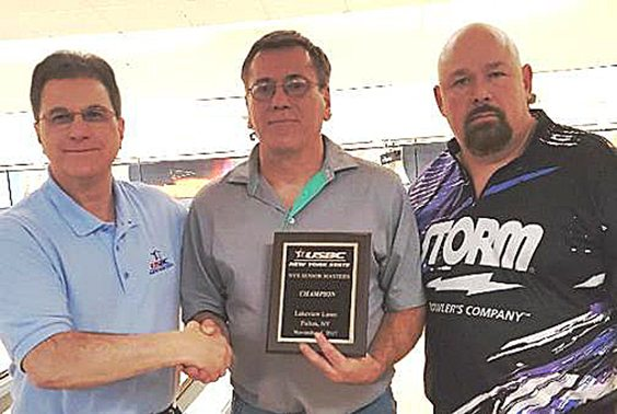 Mike Pettinella, left, congratulates champion Ray Textor of Kennedy and runner-up Sam Ventura of Norwich following an exciting final match of the first NYS Senior Masters last Saturday at Lakeview Lanes in Fulton. The tournament drew 94 entrants, well beyond what organizers expected. Submitted photo