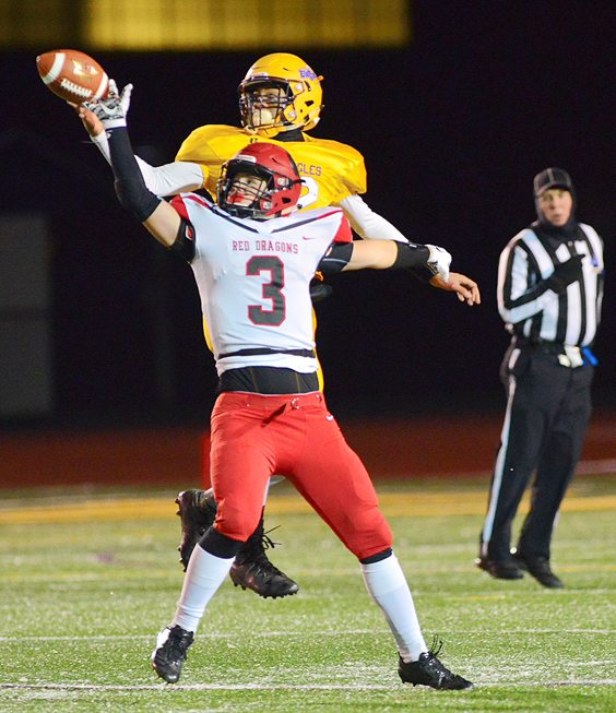 Maple Grove's Nick Fabrizio (3) breaks up a pass during Friday night's Class D Far West Regional. P-J photo by Scott Reagle