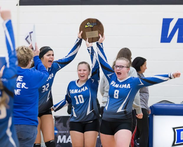 Panama's Class D Far West Regional volleyball victory over C.G. Finney complete, Panama's Gillian Figueroa (32), Quinn Payne (10) and Elle Angeletti (8) hold aloft the championship plaque Friday afternoon at Daemen College. Photo by Deb Bailey