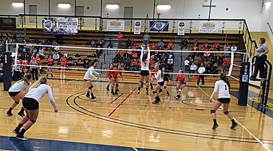 The Jamestown Community College volleyball team (in white) are seen in action during the first day of the NJCAADivision III Women's Championship. Submitted photo