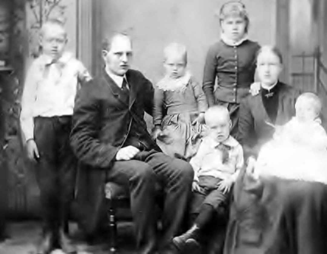 The Johnson family circa 1890 with five of 10 children who lived to adulthood. Great-grandmother Ida Hendrickson Johnson is on the right with a baby on her lap.