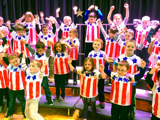 Lincoln Elementary School first graders practice for their Patriotic Concert in honor of Veteran's Day.