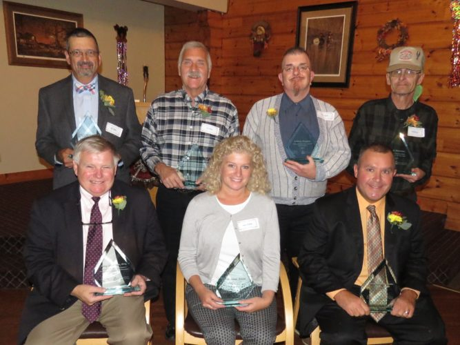 Recipients of the 2017 Disability Awareness Awards pose together. Pictured from left are, sitting, Greg Peterson, who received the Lifetime Achievement Award; Laura Seiberg, nurse manager at TRC Community Health Center, who accepted the Health Provider of the Year Award on behalf of Dr. Adnan Munir; and Patrick Smeraldo, Advocate of the Year; and, standing, Jeff Geblein, who received the Community Support Award; Tom Rhodes, Volunteer of the Year; Joshua Hughes, who received the Outstanding Achievement Award; and Phil Murvine, who was honored as one of NYSID's Outstanding Performers.