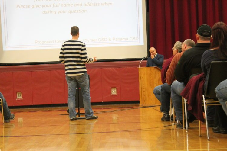 A Clymer resident speaks last week in the second of two public meetings regarding a potential merger of the Clymer and Panama school districts. If approved, staff contracts would need to be negotiated.  P-Jphoto by JordanW. Patterson