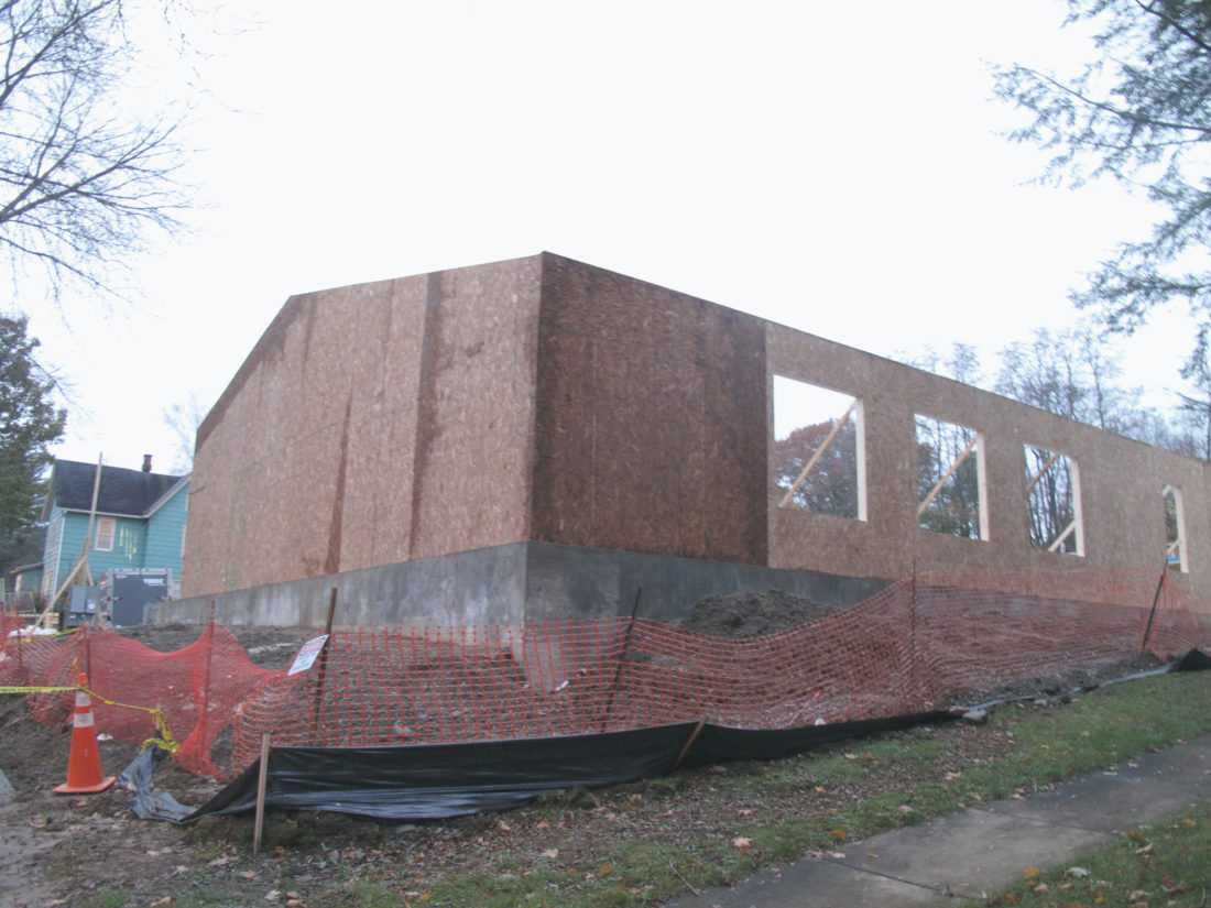 The walls of the new First Church of God on Falconer Street in Jamestown were erected on Tuesday. The church was destroyed in a fire last year, though service has continued at a next door residence.  P-J photo by Katrina Fuller