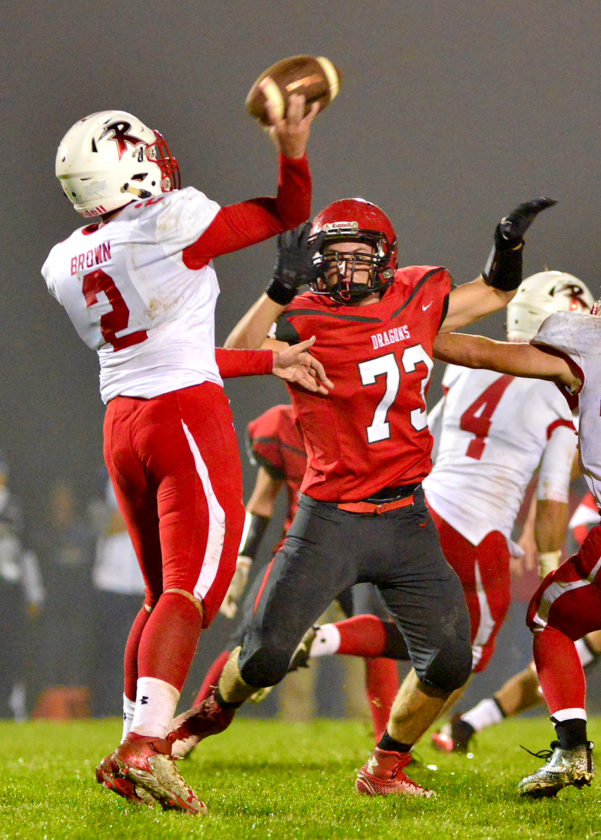 Maple Grove's Carter Russo (73) is second on the Red Dragons with 90 tackles and 5¢ sacks on the season as they enter Friday's 4 p.m. NYSPHSAA Class D state semifinal against Tioga at Union-Endicott High School. P-J file photo by Scott Reagle