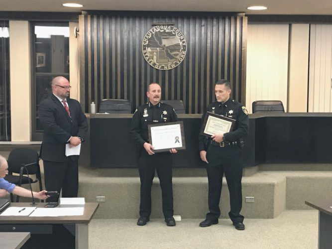 Legislator PJ Wendel, left, with Sheriff Joe Gerace and Lt. Kirk Lyon. Wendel presented the Sheriff's Office with its New York State re-accreditation. The program helps police agencies evaluate and improve performances.  P-J photo by Katrina Fuller