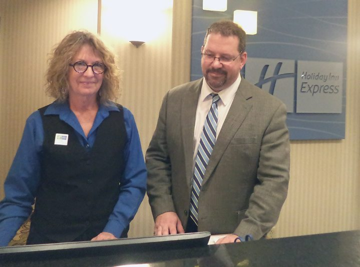 Right, Paul Leroux, general manager of the Holiday Inn Express in Findley Lake, goes over some details with front desk manager Judy Miller. Submitted photo
