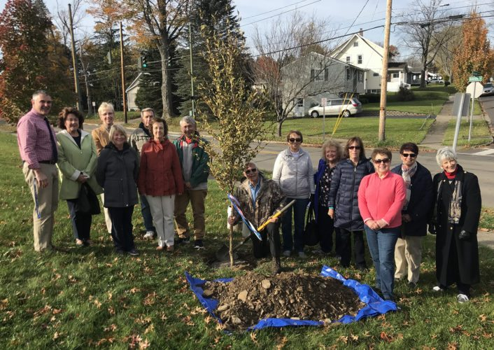 Friends and colleagues of retired Persell Middle School teacher Karen Harp Czysz recently gathered to plant a tree in her memory outside of her former classroom with the help of  Forestry Consultant Bruce E. Robinson. Not pictured is Jamestown City Arborist Dan Stone who helped facilitate the tree planting.
