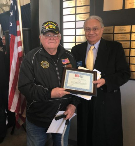 Harry J. Uhl, left, is presented with the Wall of honor certificate by Don Alessi, chairman of the board of directors at the Buffalo and Erie County Military and Naval Park on Veterans Day. Photo by Beverly  Kehe-Rowland