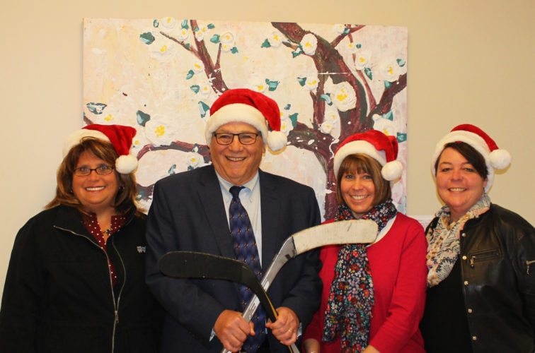 Pictured, from left, are Heather Brown, The Resource Center assistant executive director; R. Michael Goldman, chair of The Resource Center Board of Directors; Terri Johnson, The Resource Center director of employment and community-based services;  and Lisa Hatch, Jamestown Renaissance Corp. executive director.