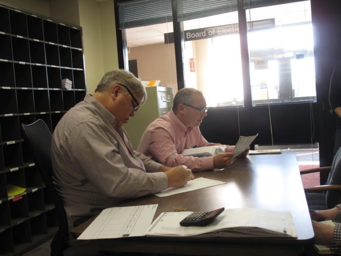 Norm Green and Brian Abram, Chautauqua County Board of Election commissioners, hand-tabulated 249 affidavit and absentee ballots for the Jamestown at-large city council race. Kim Ecklund, Andrew Liuzzo and Vanessa Weinert remained the winners.  P-J photo by Katrina Fuller