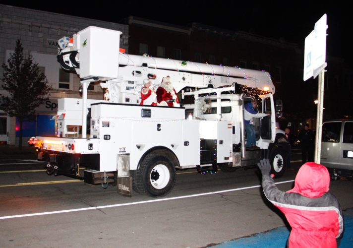 Santa and Mrs. Claus arrive at Moore Park on a village Electric Department truck Friday.