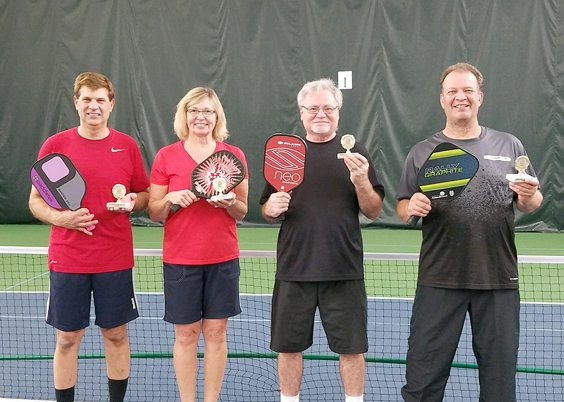 Bob Lyman and Paul Licata defeated Sam and Eileen Laporte in the 3.0 division of the Lakewood YMCA's Halloween Pickleball tournament, sponsored by the Chautauqua Federal Credit Union. Pictured, from left, are: Sam LaPorte, Eileen LaPorte, Bob Lyman and Paul Licata. Submitted photo