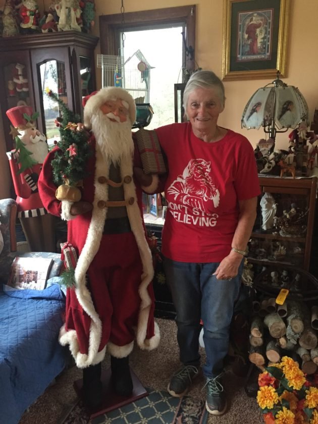 Brenda Franzen with one of three life-size Santas from her collection of over 1,000.