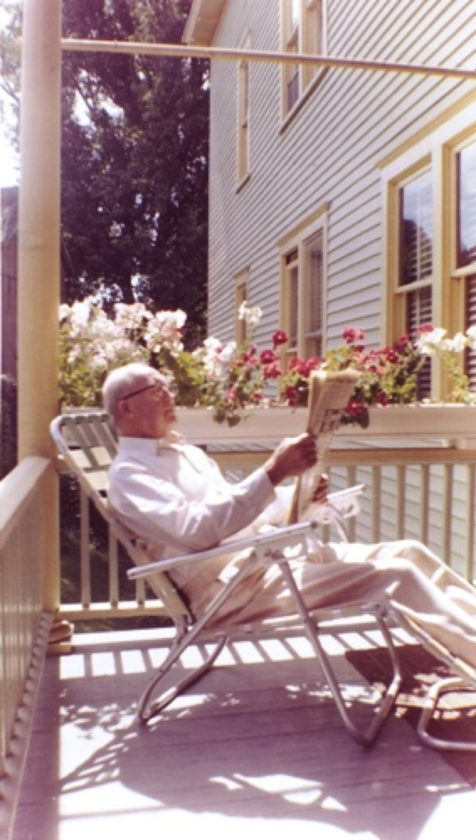 Grandfather Ben reading amidst flowers, a place he liked to be in his retirement years. Family archive photos