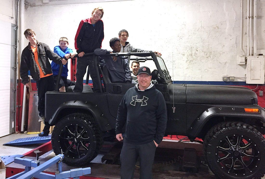 Jamestown High School students, Matt Wetherby, Matt Frederick, Orren Breen, Darius Thomas, Jose Diaz, and Alexis Natal-Guzman toured Dave Warren Auto Group with Service Manager Andy Nelson to learn more about careers in the automotive field.