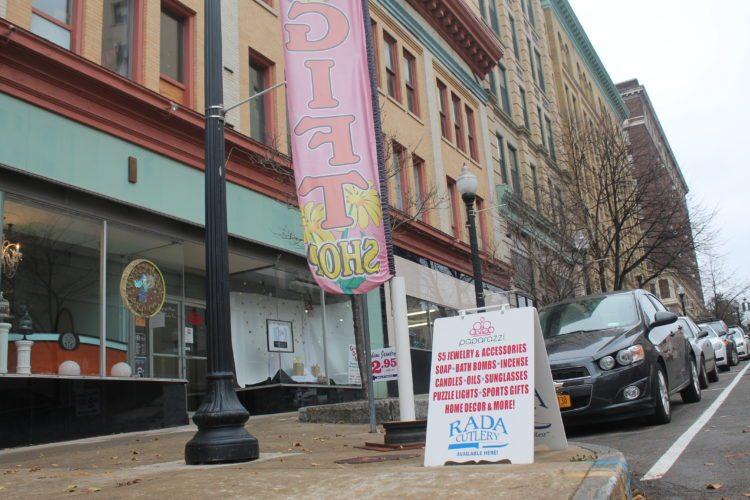Vehicles line the storefront on Cherry Street in Jamestown during Small Business Saturday.  P-J photo by Jordan W. Patterson