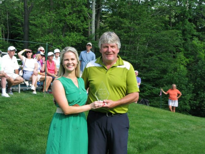 Jim Pullan Jr., owner of Jamestown Mattress, receives the Small Business of the Tournament award from Hannah Hawkins, Web.com sponsorships manager, at the LECOM Health Challenge golf tournament at Peek'n Peak Resort in July. Jamestown Mattress is now in the running to win $25,000 worth of Web.com online marketing products and services in an online voting competition alongside 19 other small businesses across the country. P-J file photo by Gavin Paterniti