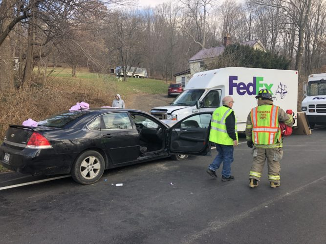 Two area residents were taken by helicopter to the hospital following a head-on crash with a parked FedEx truck on Route 430 in the town of Ellery.  P-J photo by Eric Tichy