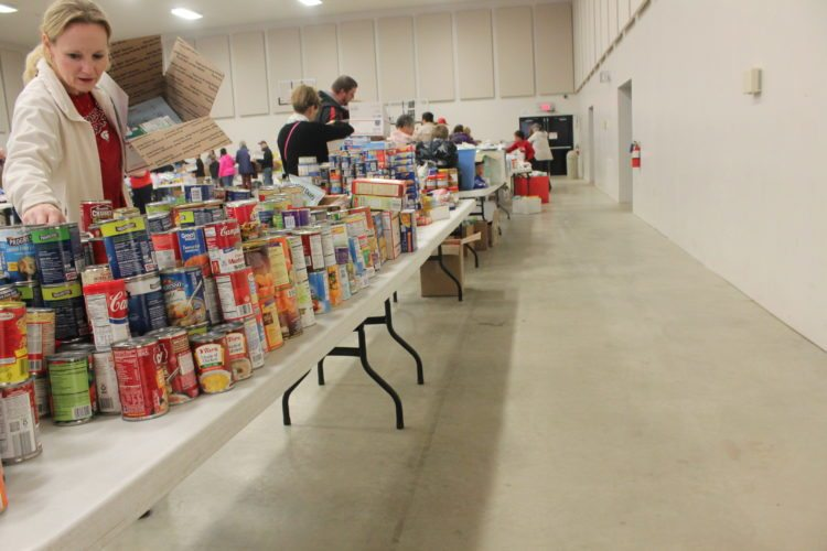Area residents gathered Saturday at the Fluvanna Community Church to fill postage boxes with items, including food and personal care items, to be sent to loved ones who serve in the military and can't be home for the holidays.  P-J photos by Jordan W. Patterson