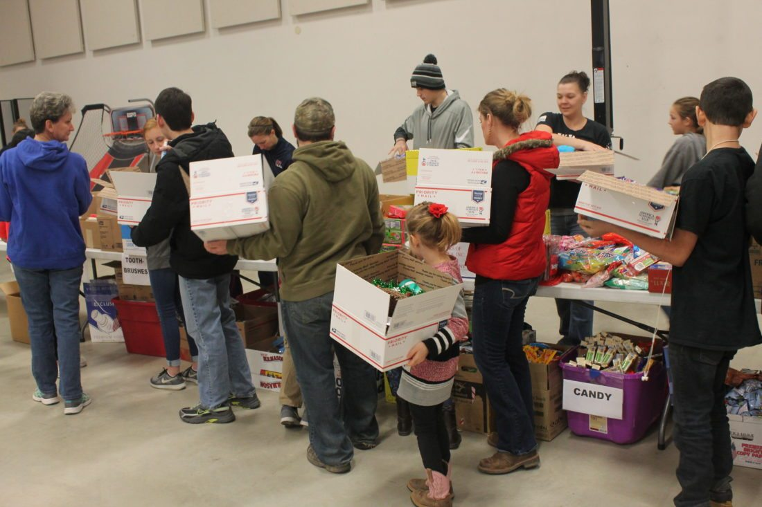 Boxes are filled Saturday at the church. The event was hosted by the local chapter of Blue Star Mothers, a nonprofit group that provides support to mothers with family in the military.