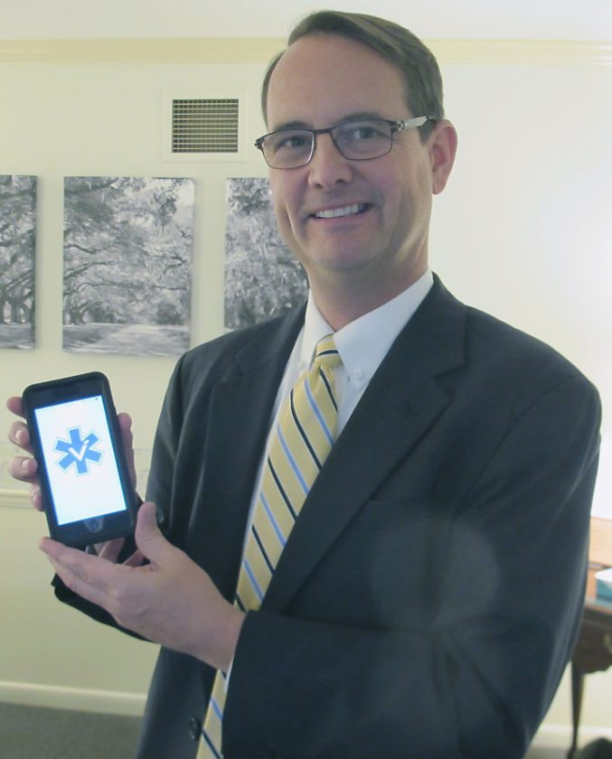 Gary Kindberg, Lind Funeral Home president, displays the Vitale ICC app on his cell phone. P-J photos by Gavin Paterniti