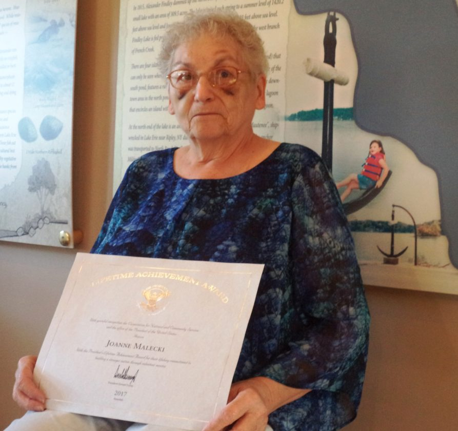 Joanne Malecki holds her certificate of lifetime service signed by President Donald Trump. Photo by David Prenatt