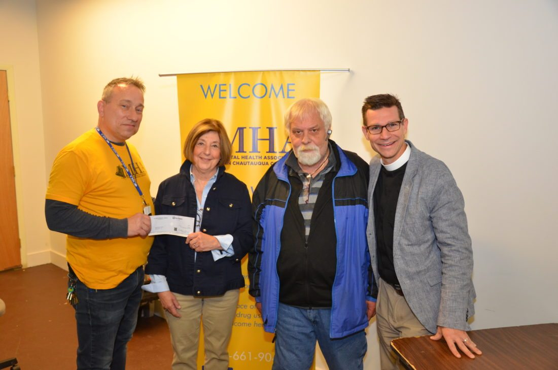St. Luke's Thrift Shop President Barb Kiddoo and Rector, the Rev. Luke Fodor, present a check for $5,000 to Steven Cobb and Rick Huber of the Mental Health Association of Chautauqua as part of the first round of block grant awards.