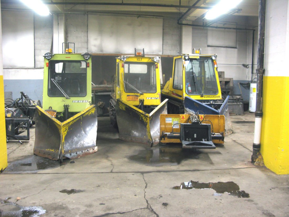 Plows used to clear Jamestown sidewalks are pictured at the city's Steele Street garage. Equipment has been readied for upcoming snow, which the region hasn't seen much of so far this year. P-Jphoto by Eric Tichy  P-Jphoto by Eric Tichy