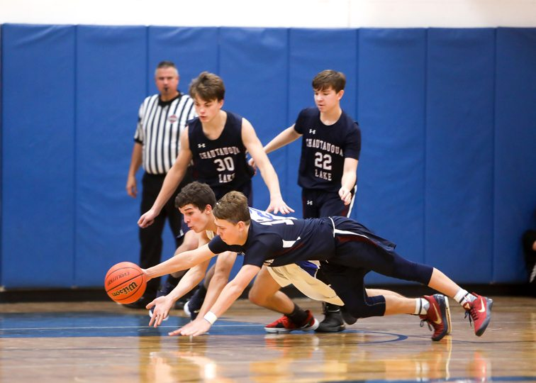 Westfield's Shawn Horr and Chautauqua Lake's Kyler Majka dive for a loose ball. Photo by Joe Conti