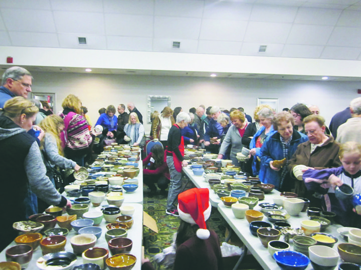 On Saturday, the public browsed through the bowls offered for sale at the Empty Bowls event held at the Clarion Hotel in Dunkirk. Local potters create one of a kind bowls offered at a range of prices. Photo by Diane R. Chodan