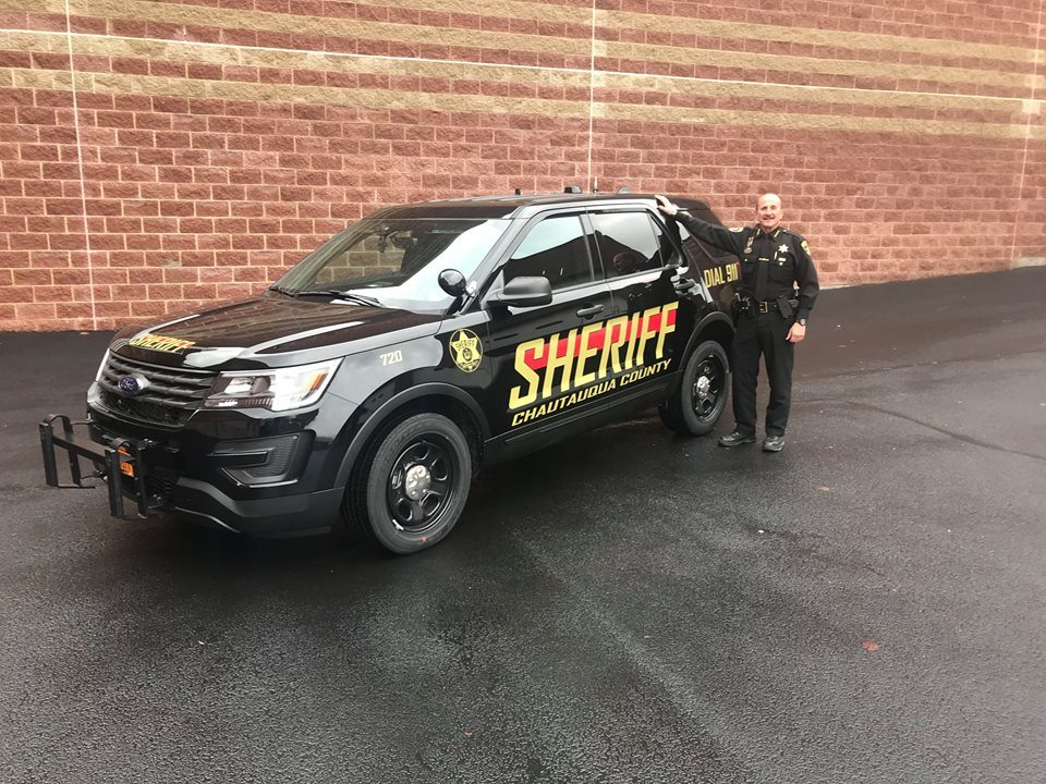 Sheriff Joe Gerace is pictured with the department's new Ford Interceptor Utility patrol vehicle. The Chautauqua County Sheriff's Office is upgrading its entire fleet while also introducing a new design, from white and red to black and gold coloring.  Photo by the Chautauqua County Sheriff's Office