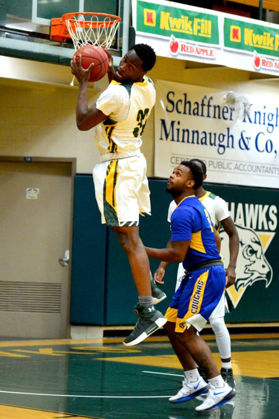 Jamestown CC's Williams Overo pulls down a rebound during Wednesday's NJCAA Region 3 Division II men's basketball game against Genesee CC at the Physical Education Complex. P-J photo by Scott Reagle