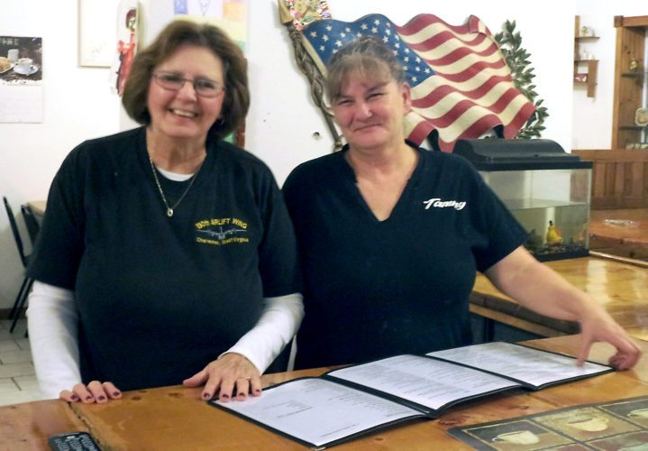 Linda Hill and restaurant owner Tammy Beaujean review the menu at Tammy's Country Kitchen on Route 20 in Ripley. P-J photo by David Prenatt