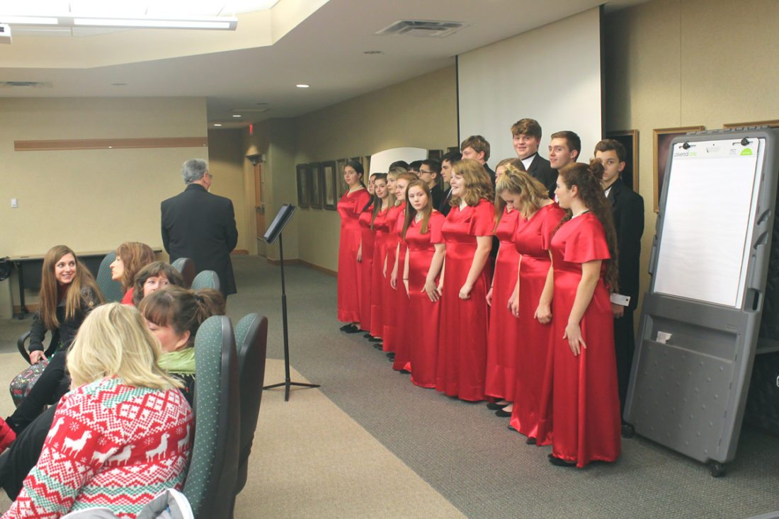 The Madrigal Singers of the Jamestown High School A Cappella Choir performed for the JPS Board of Education during a meeting on Tuesday night to preview the Jamestown High School A Cappella Choir's performance at the 93rd Vespers on Sunday and on Sunday, Dec. 17.  P-J photo by Jordan Patterson