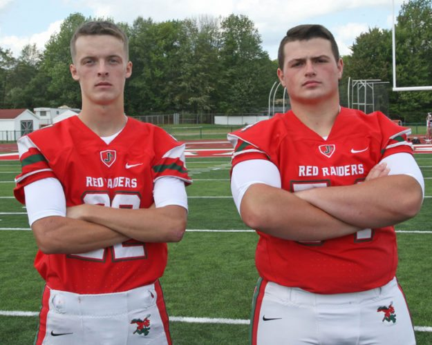 Jamestown High School football team co-captains Andrew Pumford, left, and Noah Turzillo joined teammate Manhattan King on the Class AA first-team all-star squad after leading the Red Raiders to a 5-4 record. P-J file  photo by Mark L. Anderson