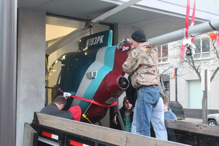 Members of the Lucile M. Wright Air Museum, with the help of volunteers, moved a Mini-500 helicopter Saturday from the museum's downtown location to the Chautauqua County-Jamestown Airport.  P-J photo by Jordan Patterson
