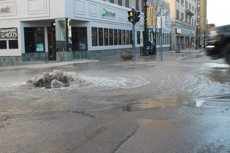 A water main broke Saturday morning at the intersection of North Main and Third streets. Discolored water is expected for up to a day once repairs are made.  P-J photo by Jordan Patterson