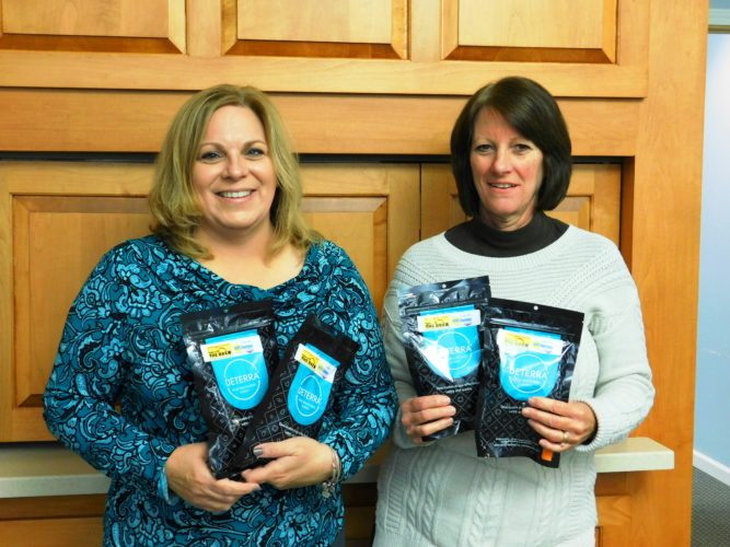 Kelley Potter, HOPE Chautauqua Community Coalition coordinator, and Shauna Anderson, CHPC president, holding Deterra medication destruction Bags.