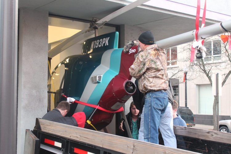 Members of the Lucile M. Wright Air Museum, with the help of volunteers, moved a Mini-500 helicopter Saturday from the museum's downtown location to the Chautauqua County-Jamestown Airport. A lease the air museum had with the Lucile Ball-Desi Arnaz Museum expires in January.  P-J photo By Jordan Patterson