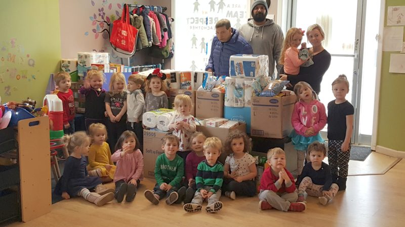 A Children's Creation pre-school is pictured with the items raised for Aspire of WNY's winter food drive for St. Susan Center.