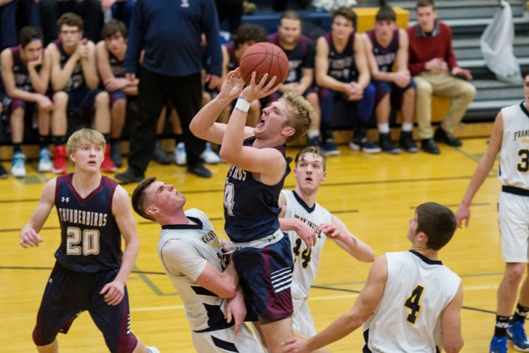 Chautauqua Lake's Devin Pope puts up a shot while being surrounded by the Franklinville trio of Sam Erickson, Dylan Burton (44) and Brock Blecha (4) during Monday's non-league game. At left is the Thunderbirds' Collin Wood (20). P-J photo by Tim Frank