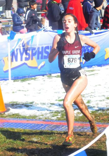 Maple Grove's Christina Peppy crosses the finish line at the New York State Public High School Athletic Association cross country championships. P-J file photo by Jay Young