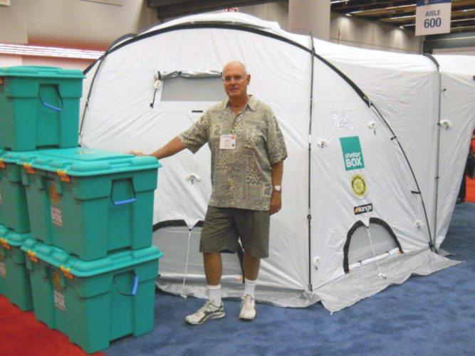 Rotary Club member Greg Jones examines a ShelterBox, which includes the tent shown and many helpful items to assist people who have incurred overwhelming natural disasters. The Rotary Club of Jamestown has donated one to be sent to hurricane victims in the Caribbean.