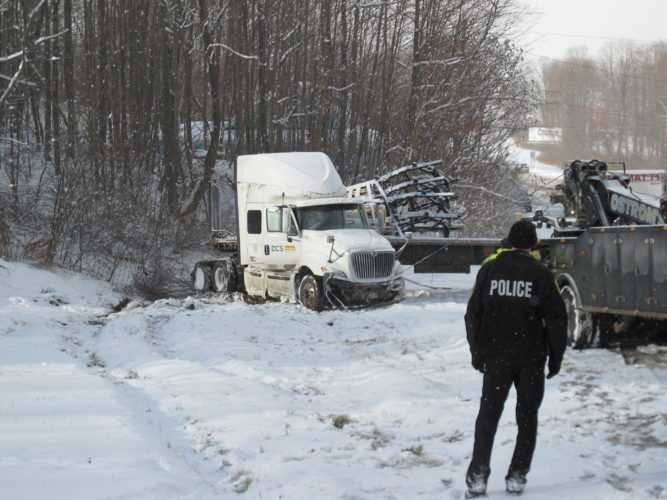 A truck is pulled from the side of Route 394 Tuesday in the town of North Harmony. Dozens of crashes were reported throughout Chautauqua County following another round of winter weather. A lake effect snow warning remains until this evening, the National Weather Service in Buffalo said.  P-J photo by Gavin Paterniti