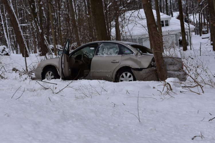 A car struck a tree on Route 430 in Bemus Point on Wednesday. Minor injuries were reported.  P-J photo by Jordan Patterson
