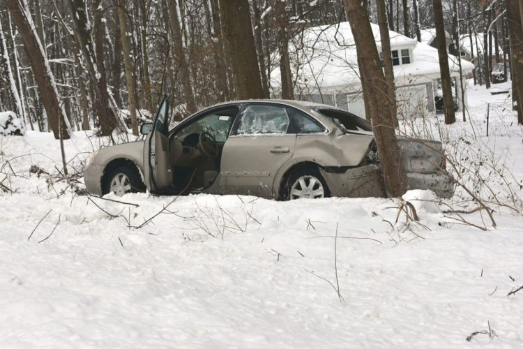 No one was seriously injured after a sedan crashed into a tree on Route 430 in Bemus Point on Wednesday. The weather reportedly played a factor in the crash, fire officials said.  P-J photo by Jordan Patterson